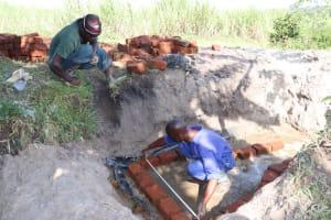The Water Project: Kalenda A Community, Moro Spring -  Brick Setting Begins
