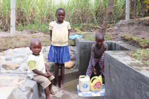 The Water Project: Kalenda A Community, Moro Spring -  At The Spring With Johnny Faith And Samwel