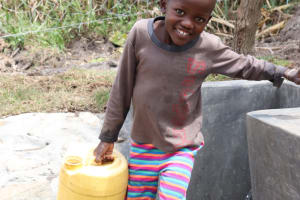 The Water Project: Kalenda A Community, Moro Spring -  Samwel Leaving With Clean Water