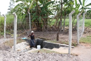 The Water Project: Kalenda A Community, Moro Spring -  Collecting Water At Moro Spring