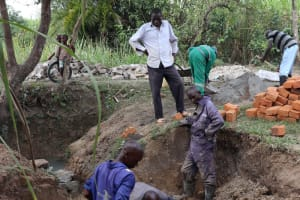 The Water Project: Luyeshe Community, Khausi Spring -  Raising The Walls