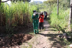 The Water Project: Luyeshe Community, Khausi Spring -  Using Teamwork To Ferry Fencing Poles