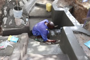 The Water Project: Luyeshe Community, Khausi Spring -  Plastering The Floor