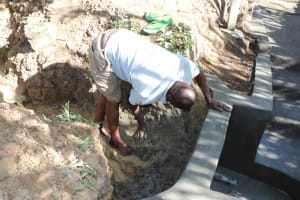 The Water Project: Luyeshe Community, Khausi Spring -  Backfilling Using Clay