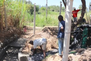 The Water Project: Luyeshe Community, Khausi Spring -  Laying The Tarp