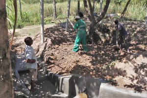 The Water Project: Luyeshe Community, Khausi Spring -  Backfilling With Soil