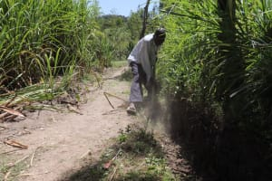 The Water Project: Luyeshe Community, Khausi Spring -  Digging The Cut Off Drainage