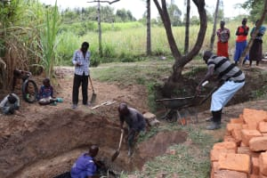 The Water Project: Luyeshe Community, Khausi Spring -  Community Members Helping The Artisan