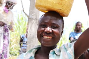 The Water Project: Luyeshe Community, Khausi Spring -  Madam Naliaka Happy To Fetch Clean Water