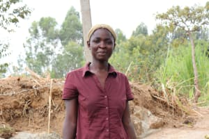 The Water Project: Luyeshe Community, Khausi Spring -  Nancy Chami On The Spring Steps