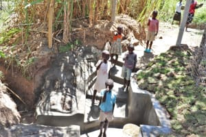 The Water Project: Luyeshe Community, Khausi Spring -  Kids Give Thumbs Up At The Spring