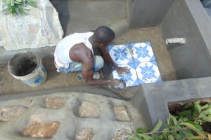 The Water Project: Indulusia Community, Osanya Spring -  Tile Setting
