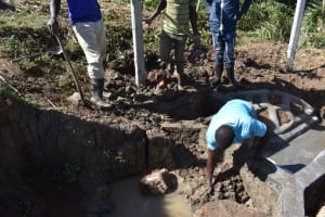 The Water Project: Indulusia Community, Osanya Spring -  Backfilling With Clay