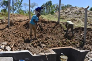 The Water Project: Indulusia Community, Osanya Spring -  Backfilling With Soil