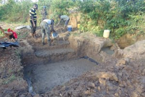 The Water Project: Indulusia Community, Osanya Spring -  Laying The Foundation For The Stairs