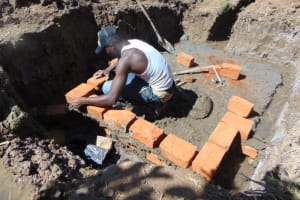 The Water Project: Indulusia Community, Osanya Spring -  Brick Setting
