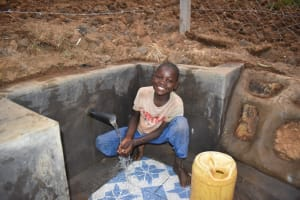 The Water Project: Indulusia Community, Osanya Spring -  Evason Enjoying Clean Water