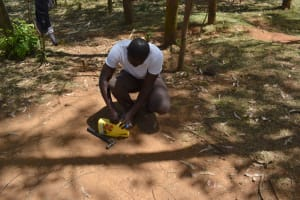The Water Project: Indulusia Community, Osanya Spring -  Making A Leaky Tin