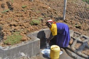 The Water Project: Indulusia Community, Osanya Spring -  Mama Osanya Enjoying Clean Flowing Water