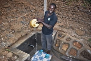 The Water Project: Indulusia Community, Osanya Spring -  Wycliffe Osanya Celebrates The Spring