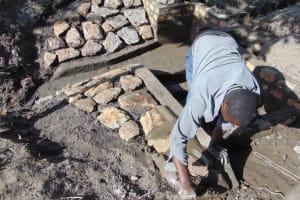 The Water Project: Makhwabuyu Community, Sayia Spring -  Stone Pitching