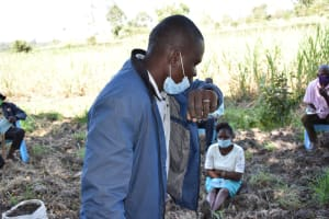The Water Project: Makhwabuyu Community, Sayia Spring -  Demonstration On How To Sneeze Into The Elbow