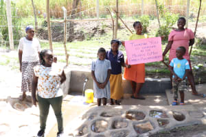 The Water Project: Makhwabuyu Community, Sayia Spring -  Director Catherine With Community Members At The Spring