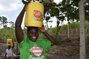 The Water Project: Makhwabuyu Community, Sayia Spring -  Irene Taking Water Home