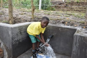 The Water Project: Makhwabuyu Community, Sayia Spring -  Simon Playing With Water