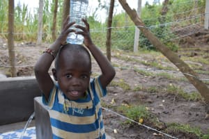 The Water Project: Makhwabuyu Community, Sayia Spring -  Little Boy Carrying Water