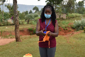 The Water Project: Mukhonje B Community, Peter Yakhama Spring -  Christine Shows How To Make A Face Mask