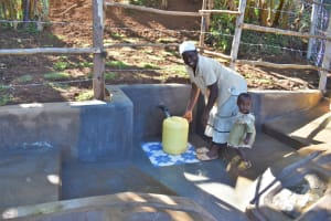 The Water Project: Mukhonje B Community, Peter Yakhama Spring -  Josphine And Her Daughter Fetching Water