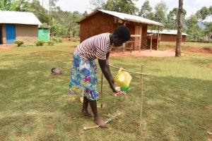 The Water Project: Mukhonje B Community, Peter Yakhama Spring -  Practicing Handwashing Using A Tippy Tap