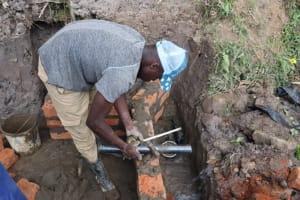 The Water Project: Shianda Community, Panyako Spring -  Pipe Setting