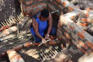 The Water Project: Shianda Community, Panyako Spring -  Field Officer Preparing Site For Stone Pitching