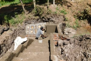 The Water Project: Shianda Community, Panyako Spring -  Plastering