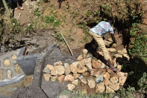 The Water Project: Shianda Community, Panyako Spring -  Backfilling With Stones And Clay