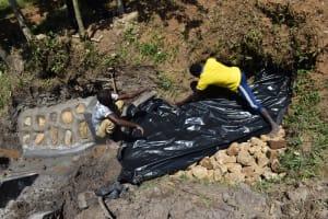 The Water Project: Shianda Community, Panyako Spring -  Laying The Tarp