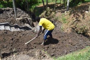 The Water Project: Shianda Community, Panyako Spring -  Backfilling With Soil
