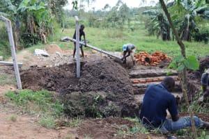 The Water Project: Shianda Community, Panyako Spring -  Erecting Fencing Poles