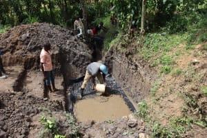 The Water Project: Shianda Community, Panyako Spring -  Setting The Foundation