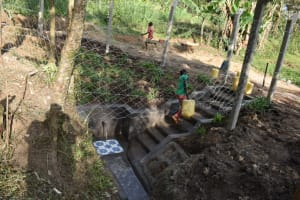The Water Project: Shianda Community, Panyako Spring -  Babu Leaving The Spring With Clean Water