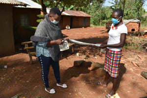 The Water Project: Shianda Community, Panyako Spring -  Demonstrating How To Make A Mask
