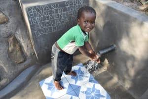 The Water Project: Shianda Community, Panyako Spring -  Emmanuel Playing With Water