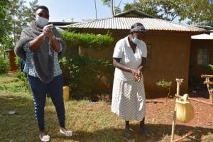 The Water Project: Shianda Community, Panyako Spring -  Facilitator Jacky And Mama Rose Demonstrating Ten Steps Of Handwashing