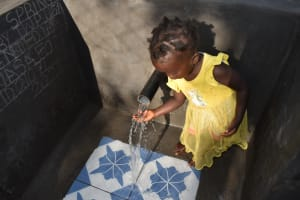 The Water Project: Shianda Community, Panyako Spring -  Favour Playing With Water