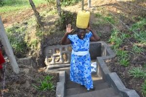 The Water Project: Shianda Community, Panyako Spring -  Mama Angel Leaving The Spring Happy