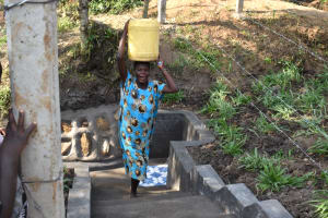 The Water Project: Shianda Community, Panyako Spring -  Mama Babu Excited To Fetch Clean Water