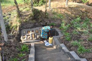 The Water Project: Shianda Community, Panyako Spring -  Mama Babu Fetching Water From Panyako Spring