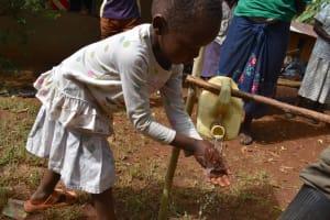 The Water Project: Shianda Community, Panyako Spring -  Mary Practicing Proper Handwashing Steps